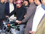 Shahbaz Sharif Distribute Free 'Helmet For All' Scheme