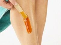 Young Woman Waxing Legs