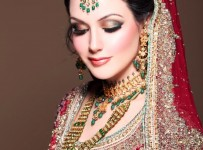 pakistani bridal makeup on red dress