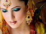pakistani bridal makeup on yellow dress